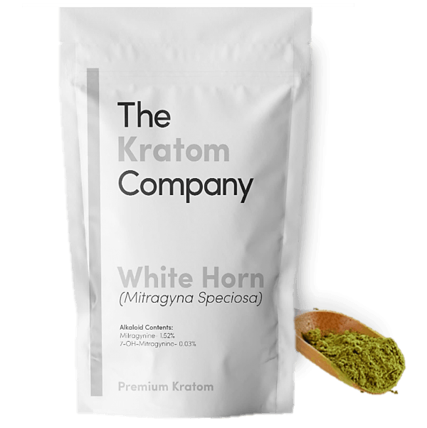 A packet of white Horn kratom powder, with some powder on a wooden vessel.